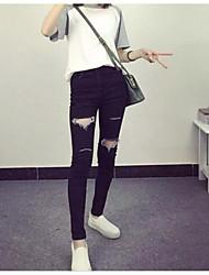Autumn new Slim was thin black hole frayed jeans pencil pants Korean wild female students