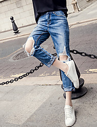 The new European station loose BF knee large hole jeans pants straight thin Harlan pantyhose sub tidal
