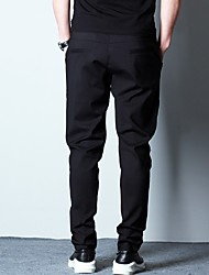 Spring black harem pants feet casual trousers feet Korean version of a solid color pants sports pants wild male pants collapse