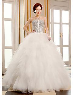Très belle robe de mariée bustier brodé de cristaux et robe composée de volants de tulle