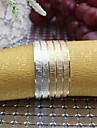 uppsättning av 4 st flerfärgade metall järn runt servettringar